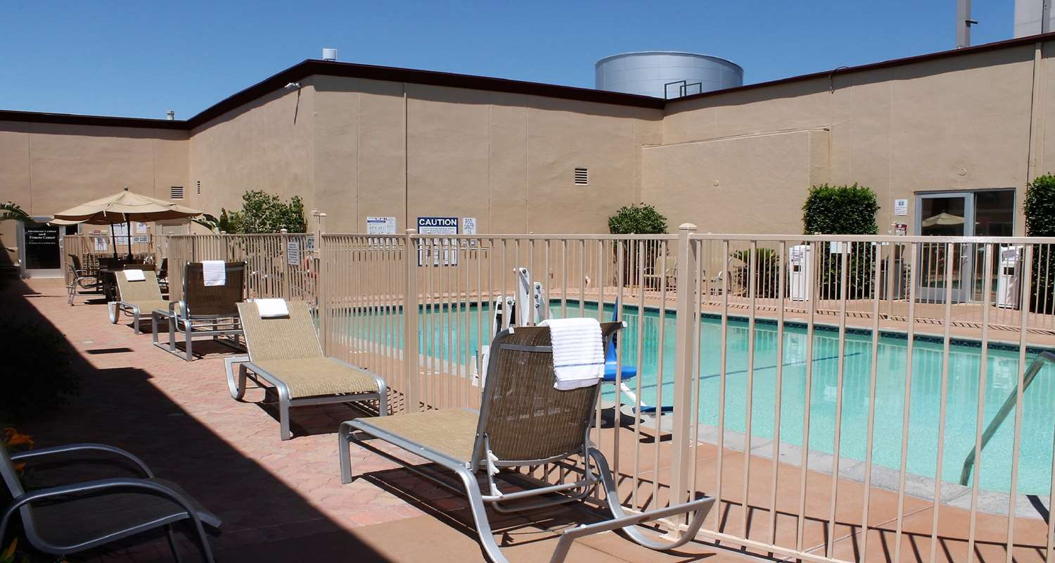 Photo of Best Western Canoga Park Pool with fence and chairs