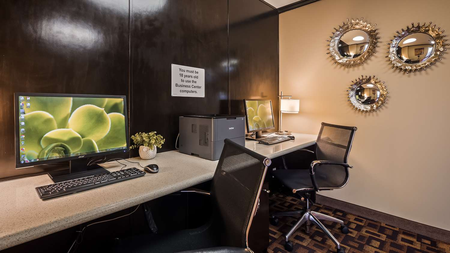 Photo of Best Western Business Center with 2 computers and chairs