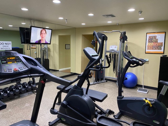 photo of fitness room showing treadmills and tv